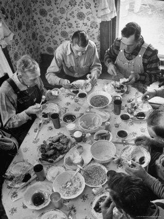 Harvest Farm Hands Eating Lunch Served by Their Wives in