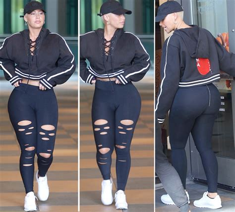 Amber Rose Adjusts Leggings To Show The Right Amount Of