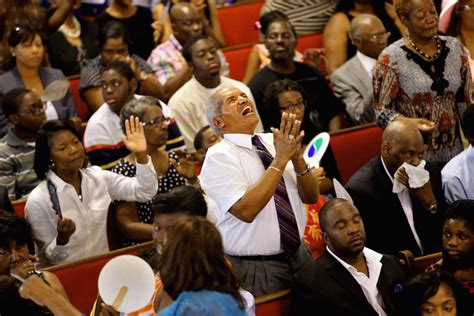 Jimmy Guyton participates in a worship service at Emanuel